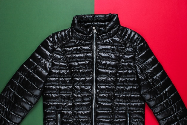 Fashionable jacket on red green surface