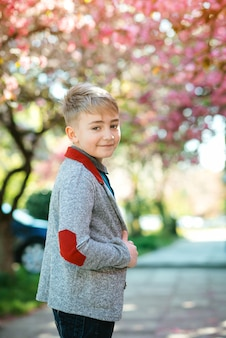 Fashionable kid in spring outdoors. portrait of handsome young boy.