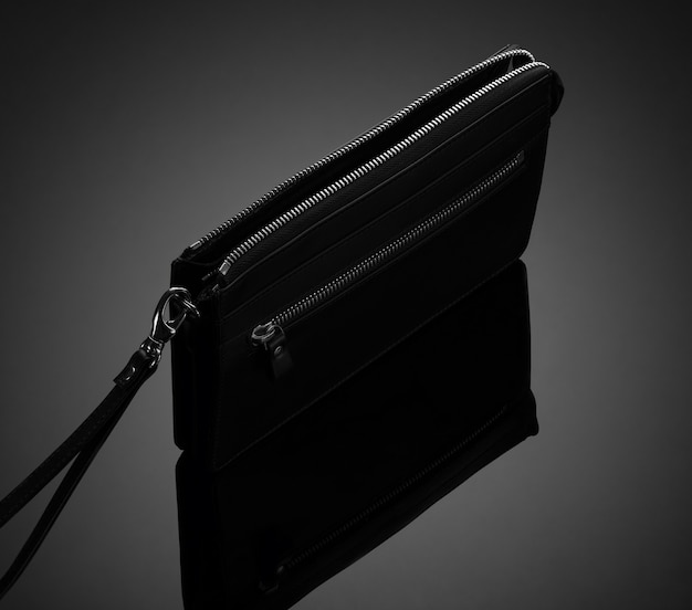 Fashionable leather men's wallet on a dark background