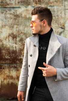 Fashionable man looking away from camera