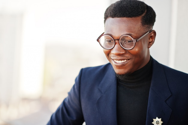 Fashionable man in suit and glasses