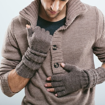 Fashionable man in winter knitted clothes