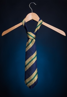Fashionable men's tie on a hanger.