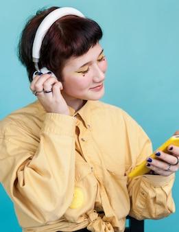 Fashionable model enjoying music