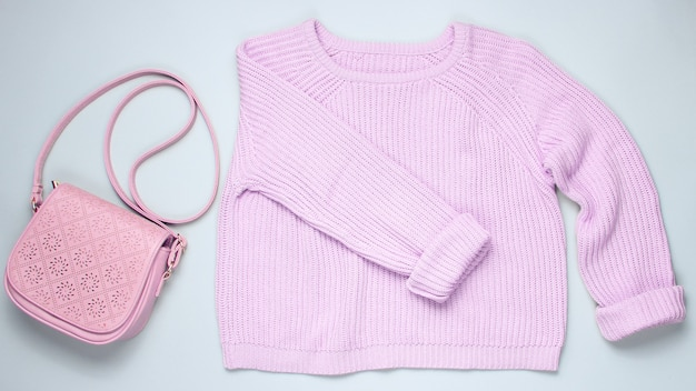 Fashionable pink pastel knitted sweater leather isolated