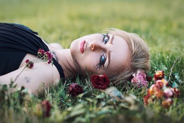 Fashionable portrait of a tearful girl with dry flowers. retro style. soft focus