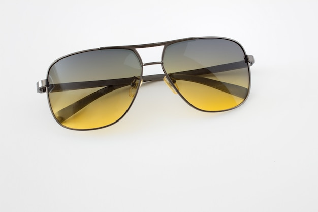Fashionable sunglasses with yellow shaded glass