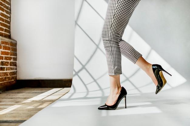 Fashionable woman in black shiny heels