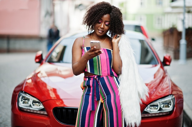 Fashionable woman in pink striped jumpsuit