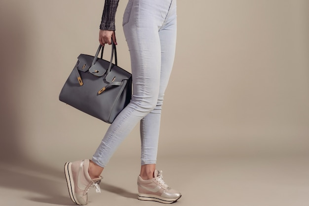 Fashionable woman with a leather bag and copy space