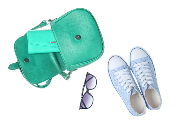 Fashionable women bag, purse, sneakers, sunglasses isolated