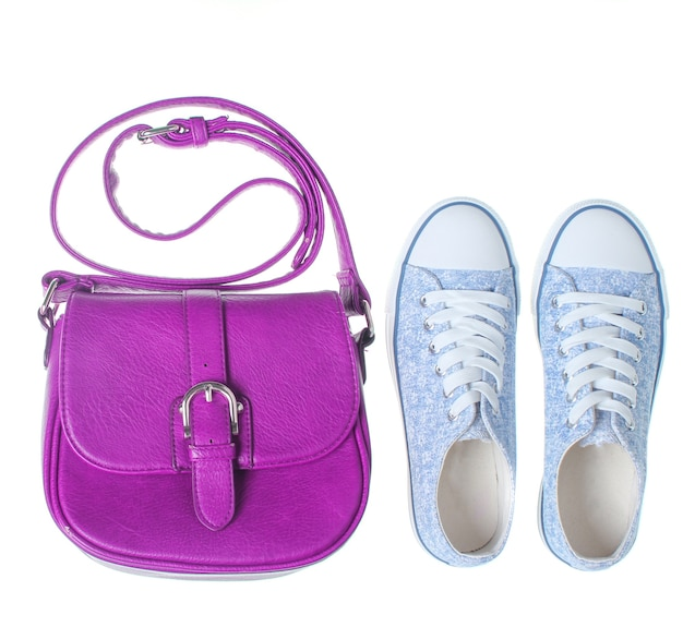 Fashionable women bag, sneakers isolated