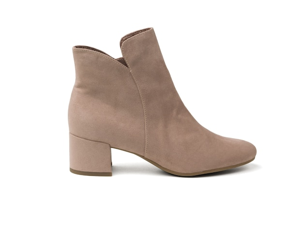 Fashionable women's suede cropped boot isolated on a white surface