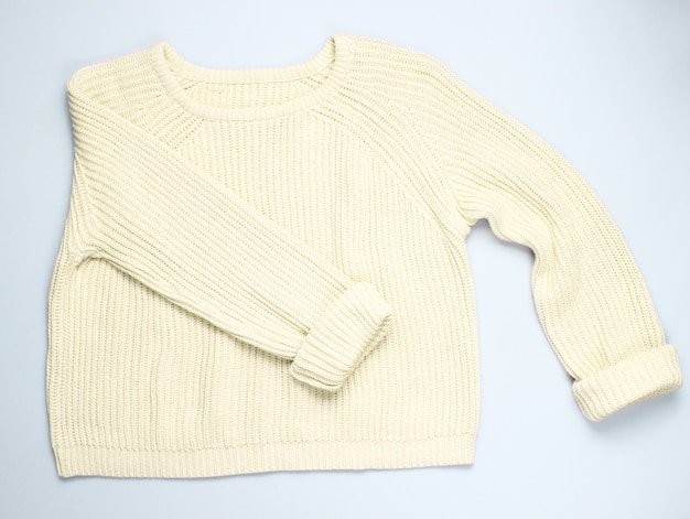 Fashionable yellow pastel knitted sweater isolated