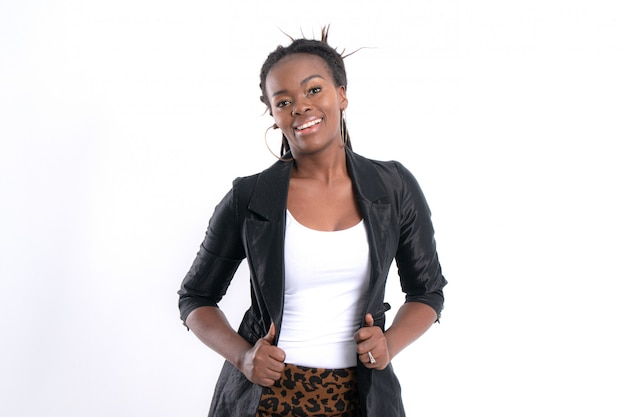 Fashionable young beautiful african woman with posing in black leather jacket.