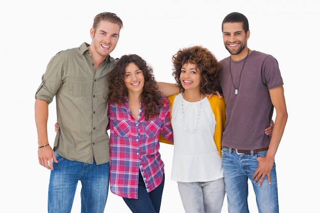 Fashionable young friends smiling on white background