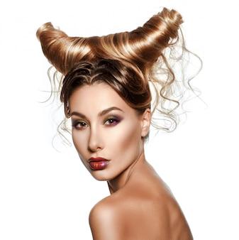 Fashionrt portrait of sexy beautiful woman with horns.