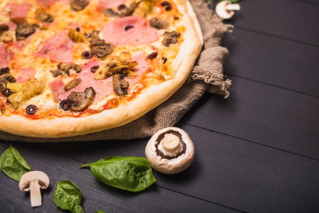 Fast food delicious pizza with mushroom and basil
