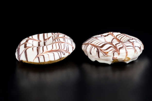 Fast food and desserts with a lot of calories, delicious doughnuts with chocolate covered filling, delicious doughnuts made of dough and filling