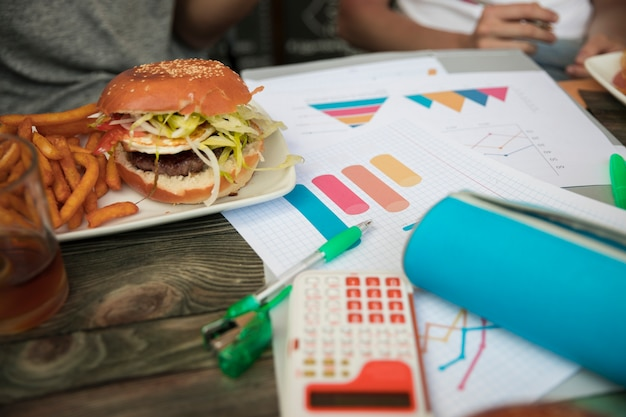 Fast food and diagrams on table