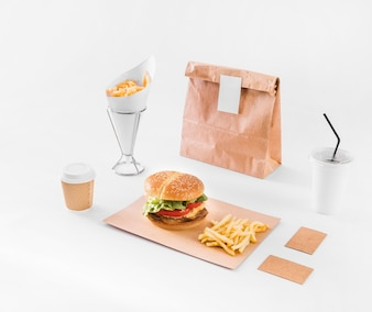 Fast food; disposal cup and parcel on white surface