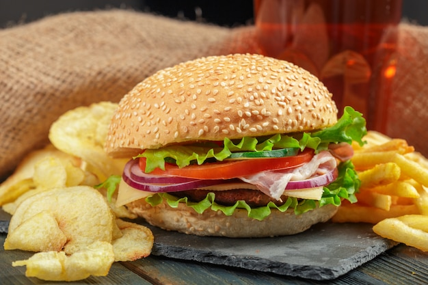 Fast food, homemade burger on a wooden background