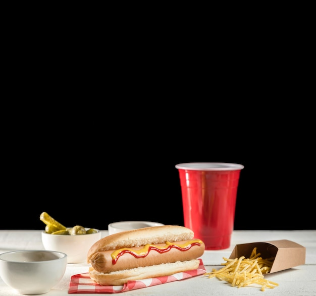 Fast food hot dog and soda copy space
