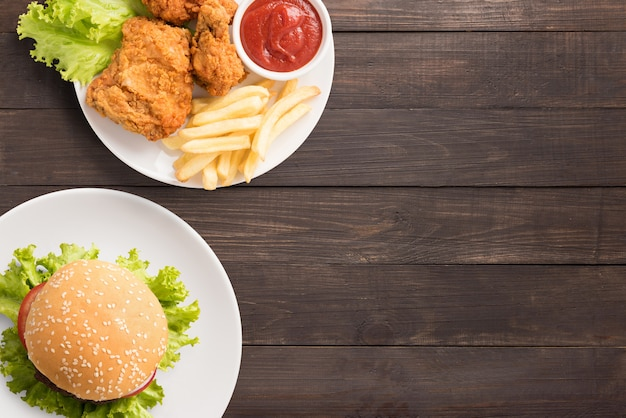 Fast food set fried chicken,french fries and hamburger on wooden background