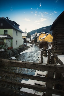 Fast mountain river going through old medieval town at austrian alps