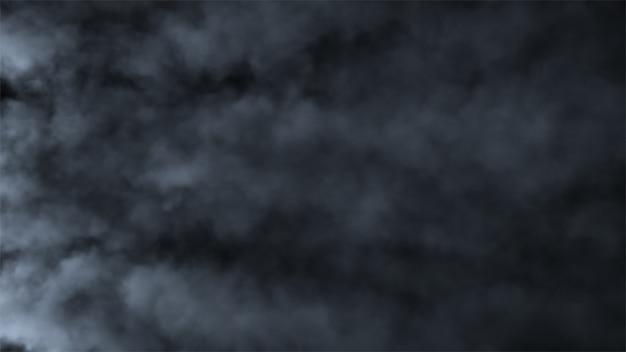 Быстро движущиеся клубы дыма на черном фоне