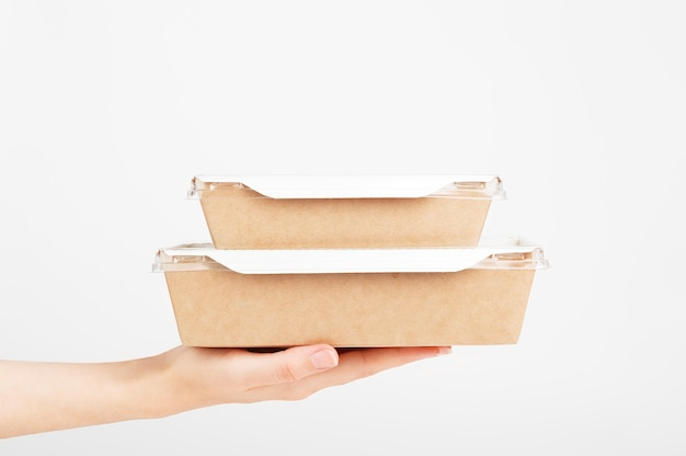 Fast shipping. female hand holding cardboard box. food delivery service.