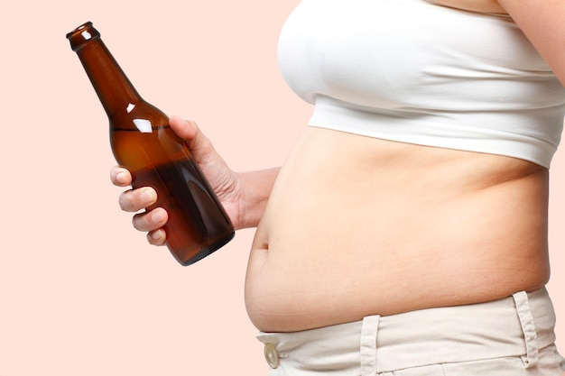 A fat belly woman with a beer in her hand