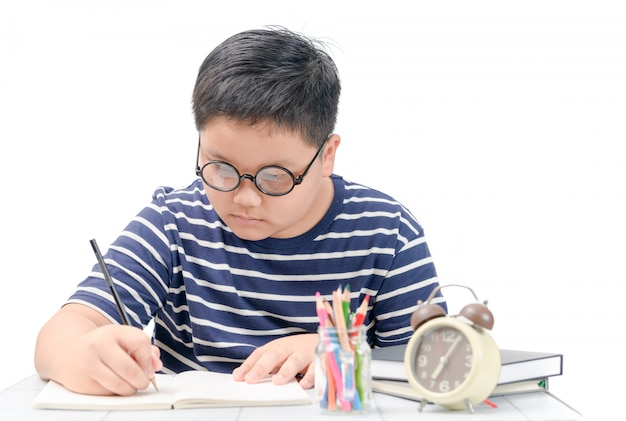 Fat boy student writing on book isolated