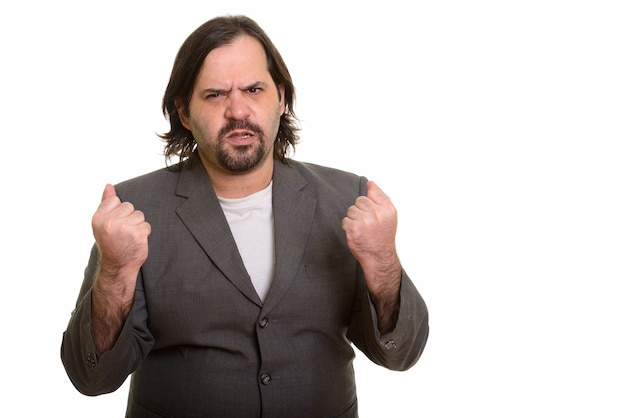 Fat caucasian businessman looking angry isolated on white