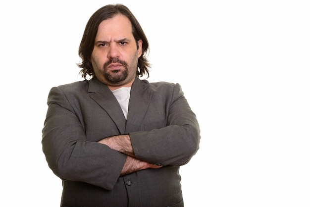 Fat caucasian businessman looking angry with arms crossed isolated on white