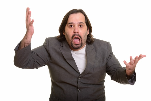 Fat caucasian businessman looking shocked isolated on white