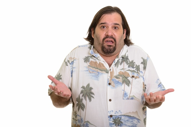Fat caucasian man looking confused with both arms raised isolated on white