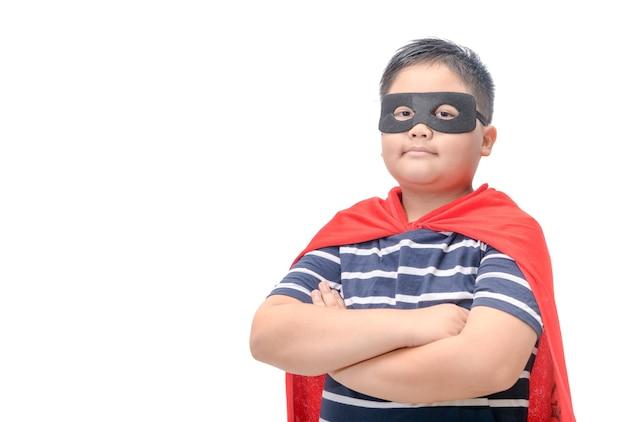 Fat child plays superhero isolated on white