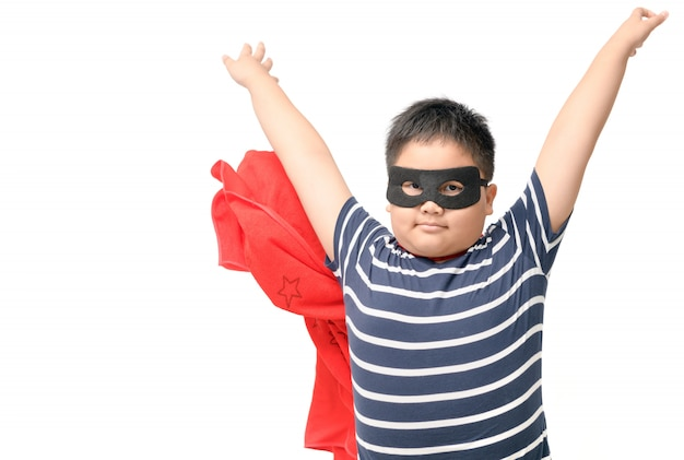 Fat child plays superhero isolated on white