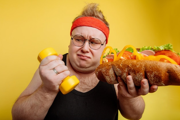 Fat man choice between sport and fast food