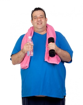 Fat man in the gym with a water bottle isolated on a white background