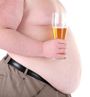 Fat man holding glass of beer, on white