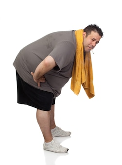 Fat man playing sport and smoking isolated on a white background