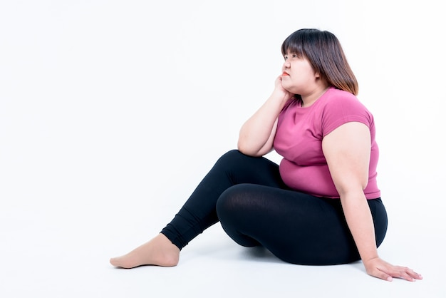 Fat sad woman sitting isolated