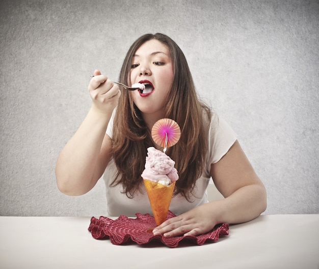 Fat woman eating ice cream