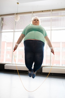 Fat woman jumping with rope
