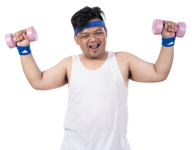 Fat young happy man with dumbbells looking a camera