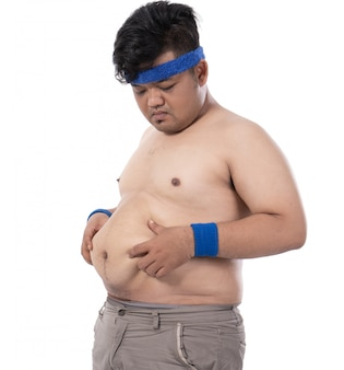 Fat young man pinch excess fat that has around his waist