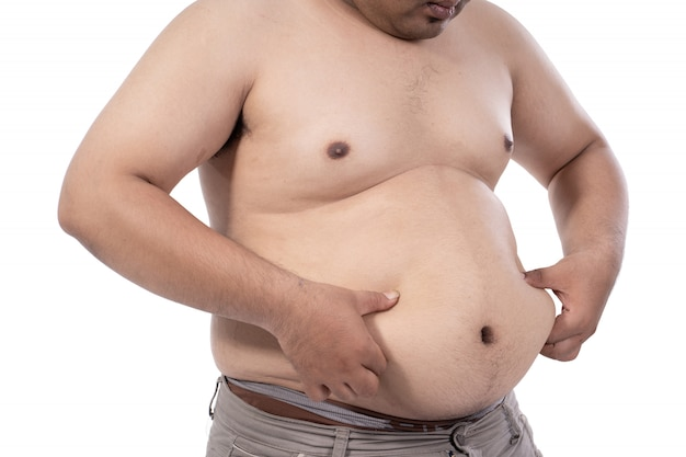 Fat young man stressed and pinch excess fat on waist