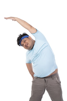 Fat young men warm up the abdominal muscles
